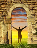 A man standing at the gate to paradise. Stock Photo