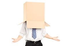 Man standing and gesturing with a cardboard box on his head. Isolated on white background Royalty Free Stock Photo