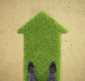 Man standing on grass  arrow Stock Images