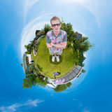 Man standing on the grass in the garden Stock Photo