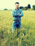 Man standing in green field Royalty Free Stock Images