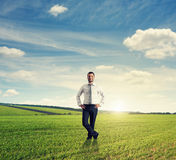 Man standing on green field Stock Images