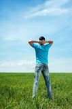 Man standing on green meadow Royalty Free Stock Photos