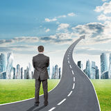 Man standing on grey freeway going up as arrow Royalty Free Stock Photo