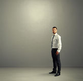 Man standing in the grey room Royalty Free Stock Photos