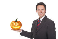 Man standing with a halloween pumpkin on his hand Stock Images