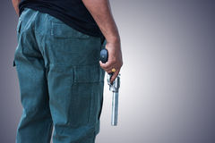 Man standing and hand holding gun revolver Stock Photo