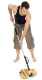 Man standing with hand on mop Stock Photos