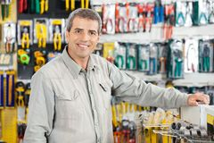 Man Standing In Hardware Store Royalty Free Stock Images