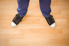 Man standing on hardwood floor Royalty Free Stock Photos