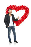 Man standing with heart shape Royalty Free Stock Images