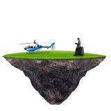 Man standing with helicopter on green grass. Use for high class traveler Royalty Free Stock Photos
