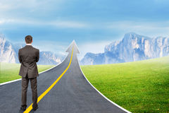 Man standing on highway road going up as arrow Stock Photo