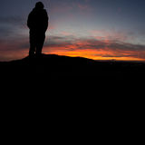 Man standing on hill in black forest at sunset Royalty Free Stock Photos