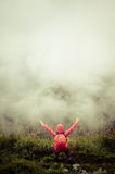 Man standing on hill with fog. Hiker on the mountain peak Stock Photography