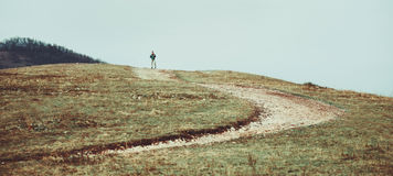 Man standing on the hill Stock Image