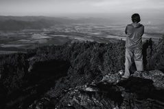Man Standing on Hill Royalty Free Stock Photos