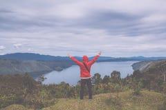 Lake toba, medan, Indonesia. Man standing on hill over Lake toba, medan, Indonesia Royalty Free Stock Photos
