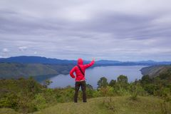 Lake toba, medan, Indonesia. Man standing on hill over Lake toba, medan, Indonesia Stock Photos