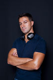 Man standing with his arms crossed and headphones Royalty Free Stock Photo