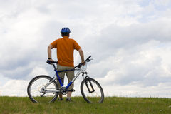 Man standing by his mountain bike Stock Image
