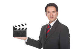 Man standing and holding clapboard on his hand Royalty Free Stock Images