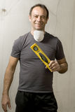 Man Standing Holding Level - Vertical Stock Photo