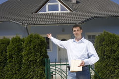 Man standing before the house Stock Photo