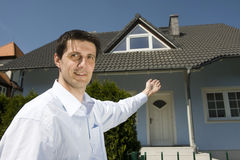 Man standing before the house Stock Images
