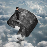 Man standing on huge 3D concrete question mark sky clouds Stock Image