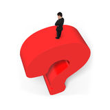 Man standing on huge 3D red question mark white background. Man standing on top of huge 3D red question mark isolated on white background Royalty Free Stock Image