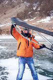 Man standing on ice with wing in the hands. Stock Photography