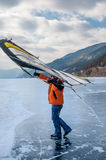 Man standing on ice with wing in the hands. Royalty Free Stock Photos