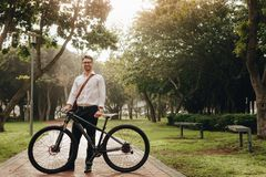 Free Man Standing In Park With His Bike Royalty Free Stock Image - 138012946