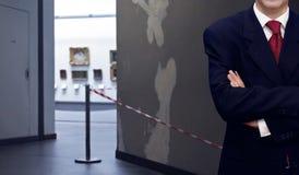 Man standing inside museum interior Stock Image