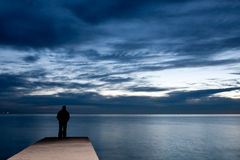 Man is standing on a jetty Stock Photos