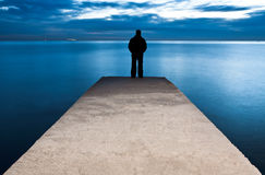 Man is standing on a jetty Stock Image