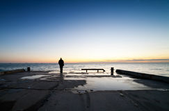Man is standing on a jetty Royalty Free Stock Photo