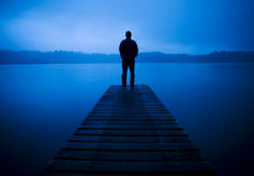 Man Standing on a Jetty by Tranquil Lake Concept Royalty Free Stock Photos
