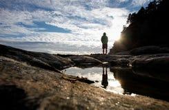 Man standing at lake Stock Photo