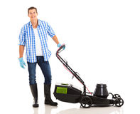 Man standing lawnmower Royalty Free Stock Image