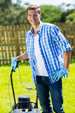 Man standing lawnmower Stock Images