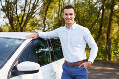 Man standing leaning on car royalty free stock photo