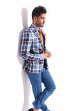 Man standing with legs crossed in studio Royalty Free Stock Image
