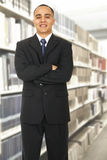 A Man Standing In Library Stock Images