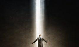 Man standing in light Stock Photos