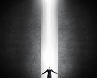Man standing in light Royalty Free Stock Images