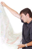 Man standing and looking at maps in his hands Royalty Free Stock Photo