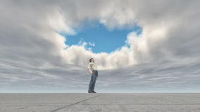 Man standing looking at the sky Royalty Free Stock Photo