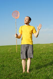 Man standing on meadow and holding butterfly net Royalty Free Stock Photos